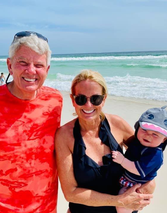 Lori Allen, her husband Eddie, and their Grandson Jack at the beach on vacation