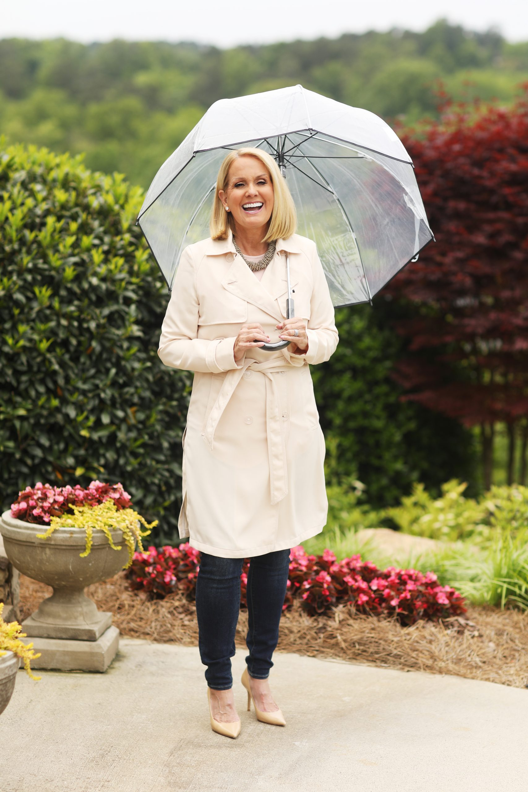 Lori Allen wears a trench coat in the rain