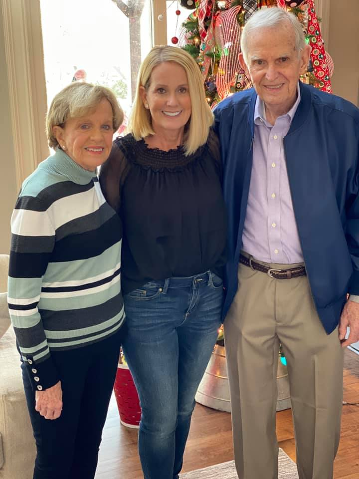 Lori Allen with her parents during the holiday season